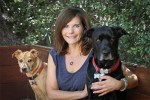 author-and-dog-adoption-expert-diane-rose-solomon-poses-with-her-two-dogs