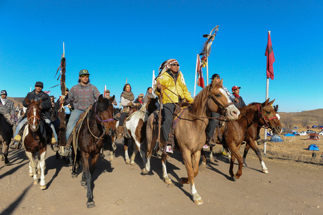 Horse riders from the Bigfoot Riders, Dakota 38 Riders, Spirit Riders and the Bigfoot Youth Riders arrive at the Oceti Sakowin camp during a protest of the Dakota Access pipeline on the Standing Rock Indian Reservation near Cannon Ball, North Dakota. Photo Credit: Stephanie Keith, Reuters