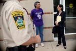 Professor with volunteer outside Superior Court in Manchester, Conneticut about custody case involving two abused dogs