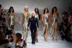 Italian fashion designer Donatella Versace with models at fashion show