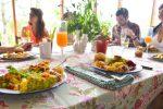 family sitting at table during vegan easter brunch