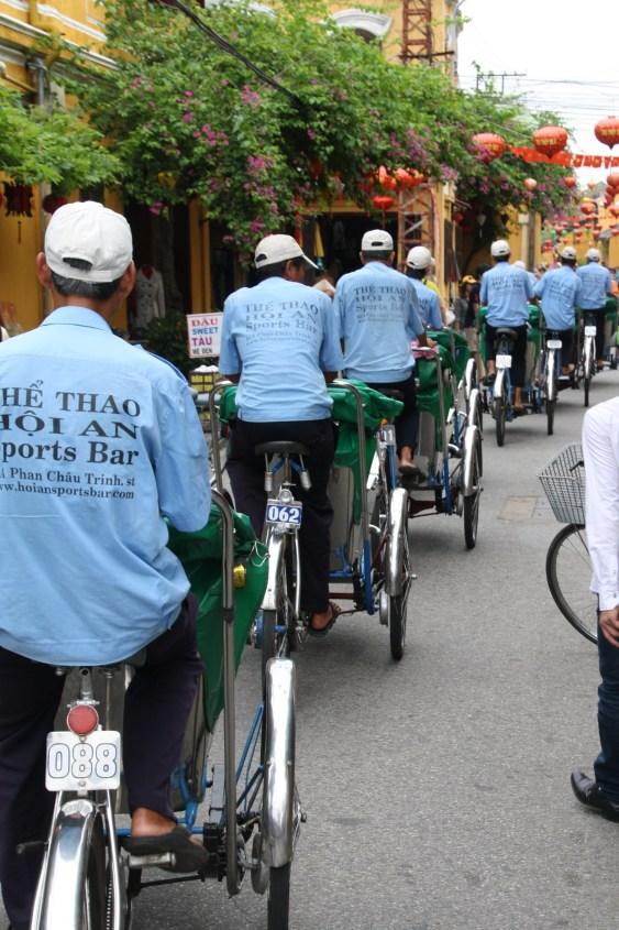 Cycle-rickshaw drivers take a tour group through the ancient town.