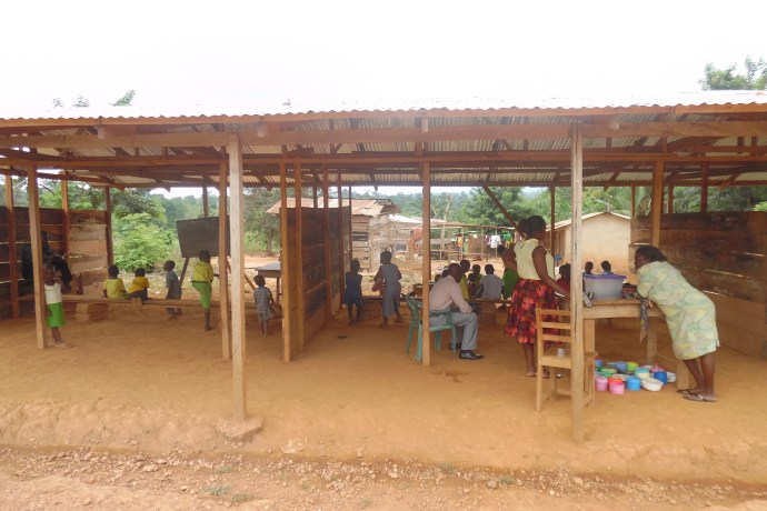 students and teachers gather in dusty classrooms