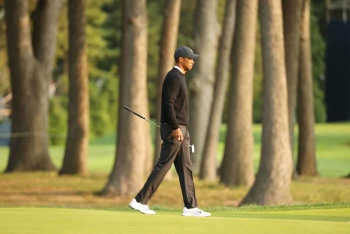Tiger Woods walks alone