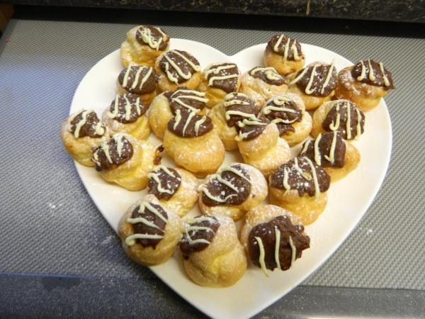 Chocolate profiteroles dusted with icing sugar Photo by PH Morton
