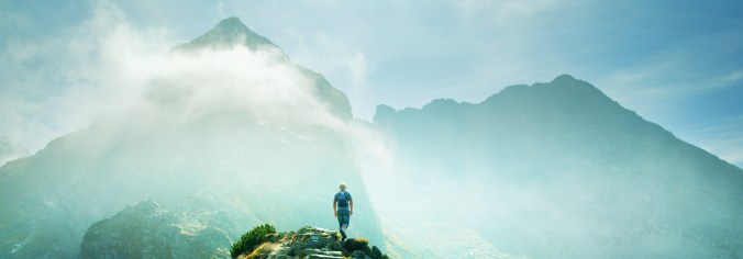 Man hiking in the mountains. Vibrant colors.