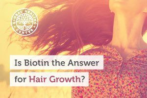 A woman with long healthy hair. Biotin might play a role in hair growth.