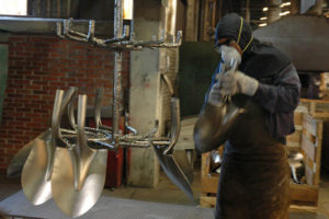 Shovels being forged out of guns