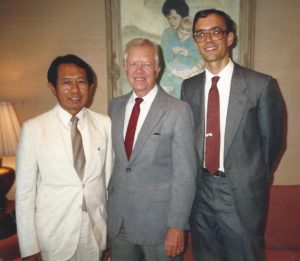 Saboi Jum and Dan Buttry meet with Jimmy Carter during the 1989 peace efforts.
