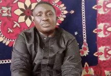 A Missing Pastor Polycap Zango In Plateau Found In New Boko Haram Video Begging Nigerian Government To Rescue Him