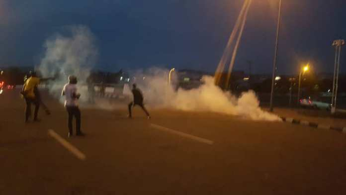 Nigerian Police Violently Disperse #EndSARS Protesters At Force Headquarters In Abuja