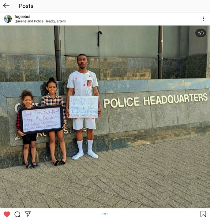 Photos Of A Nigerian Man Protesting In Australia With His Daughters