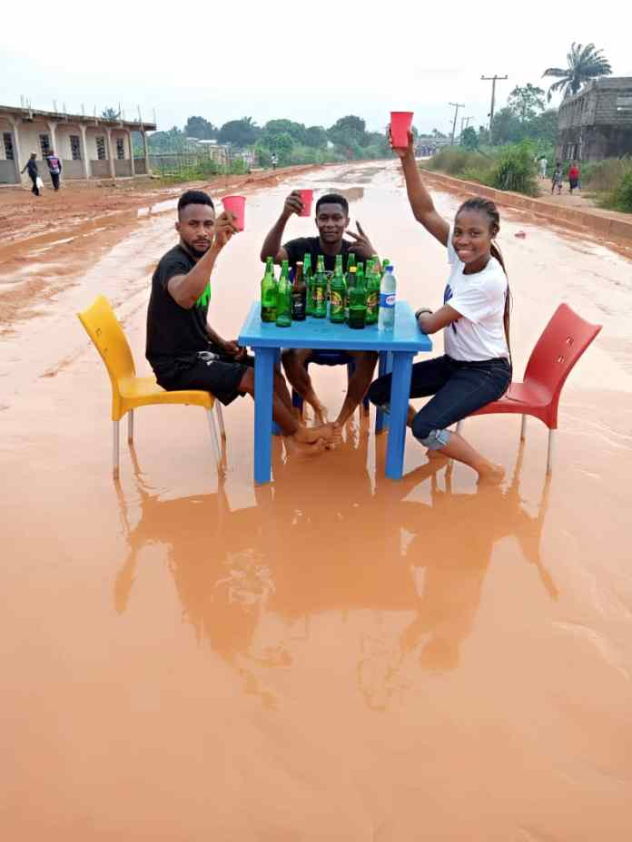 Photos Of Youths Drinking Beer On A Muddy Bad Road In Owerri Imo State