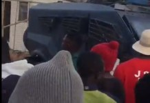 Video Of Armored Tanks Guarding Plateau COVID-19 Palliatives Warehouse As Youths Break In