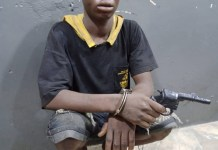 A 19 year old suspected armed robber Ajayi Lateef arrested with dummy gun in Lagos