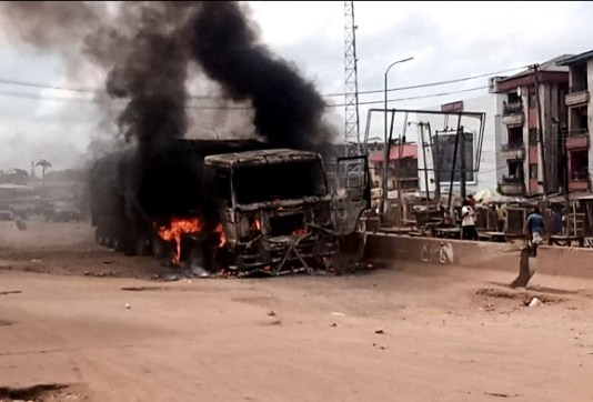 A Truck Fully Loaded With Salt Set Ablaze In Onitsha After Driver Crushed Cart Pusher To Death