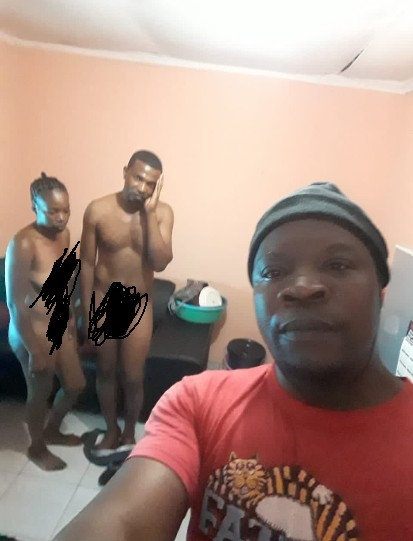 A Man Catches His Wife Sleeping With Another Man And Takes A Selfie With Them
