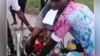 Video of the woman whose leg got hooked in a bike chain due to bad road in delta state