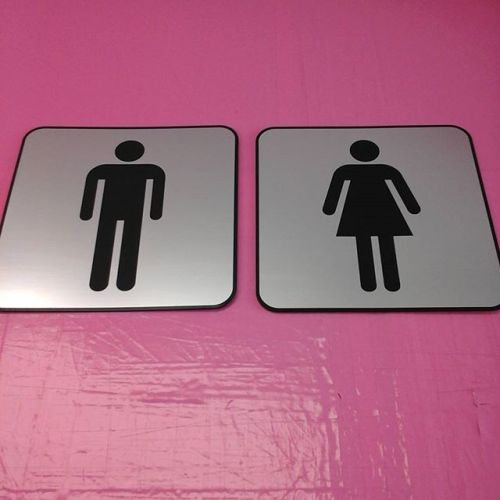 Lasered washroom door signs