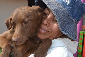 Peru Dog Rescue worker with one of the dogs