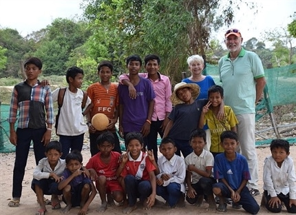 volunteers and students after a game of football Cambodia
