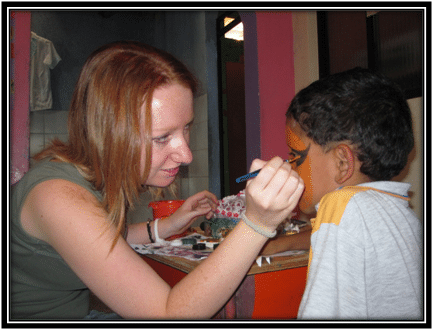 Volunteer face-painting Colombia Kids Project