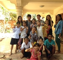 children and volunteers in Cambodia at the community project