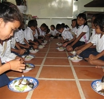 Students eating breakfast at Cambodia Community Programme