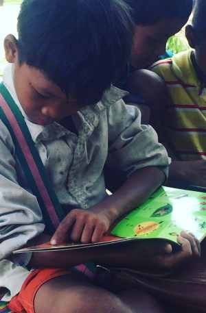 Helping Hands Reading Club Student Reading