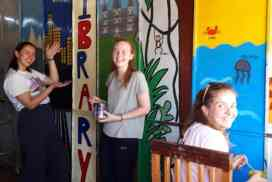 volunteers painting at kids project Siem Reap Cambodia