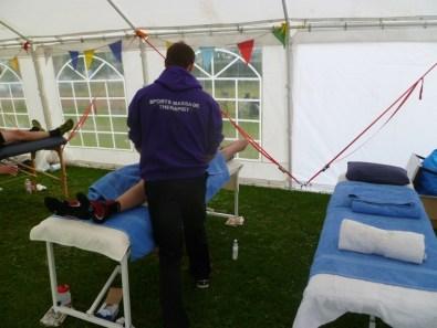 Tim massaging a runner