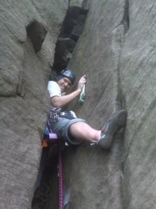 Global Therapies: Tim lead climbing Karabiner Chimney at the Roaches