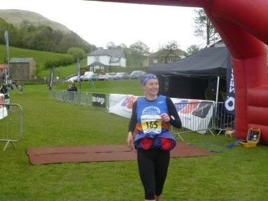 Smiling on the finish line of my first ever marathon, the Howgills Montane Trail 26