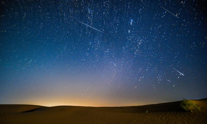 Photo taken on Aug. 13, 2021 shows the night sky during the Perseid Meteor Shower above an ecological demonstration zone of Engebei in Kubuqi Desert, north China's Inner Mongolia Autonomous Region.Photo:Xinhua