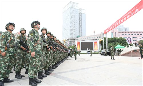 Armed police officers attend an oath-taking ceremony at the People's Square on Saturday in Urumqi, Xinjiang Uyghur Autonomous Region. At least 24 civilians and police officers were killed during a recent terrorist attack. Photo: CFP