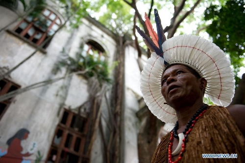 An indigenous man walks outside the old Indian Museum in Rio de Janeiro, Brazil, Jan. 16, 2013. The government of Rio de Janeiro plans to tear down an old Indian museum beside Maracana Stadium to build parking lot and shopping center here for the upcoming Brazil 2014 FIFA World Cup. The plan met with protest from the indigenous groups. Now Indians from 17 tribes around Brazil settle down in the old building, appealing for the protection of the century-old museum, the oldest Indian museum in Latin America. They hope the government could help renovate it and make part of it a college for indigenous Indians. (Xinhua/Weng Xinyang)