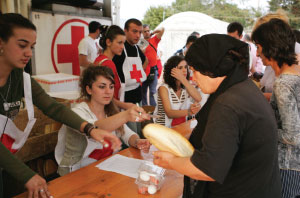 BREAKING BREAD Red Cross workers distribute food at a Gori, Georgia, refugee camp in 2008. Red Cross monitors its cold chain and must dispose of food not kept at safe temperatures.