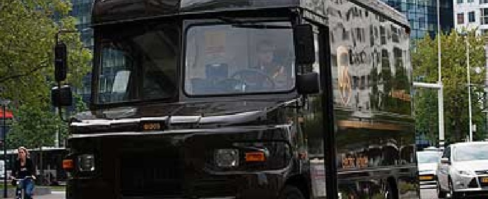 UPS test of electric vehicle in London could lower caarbon footprint of shipments of export cargo and shipments of import cargo in international trade and impact shippers' supply chains and logistics.