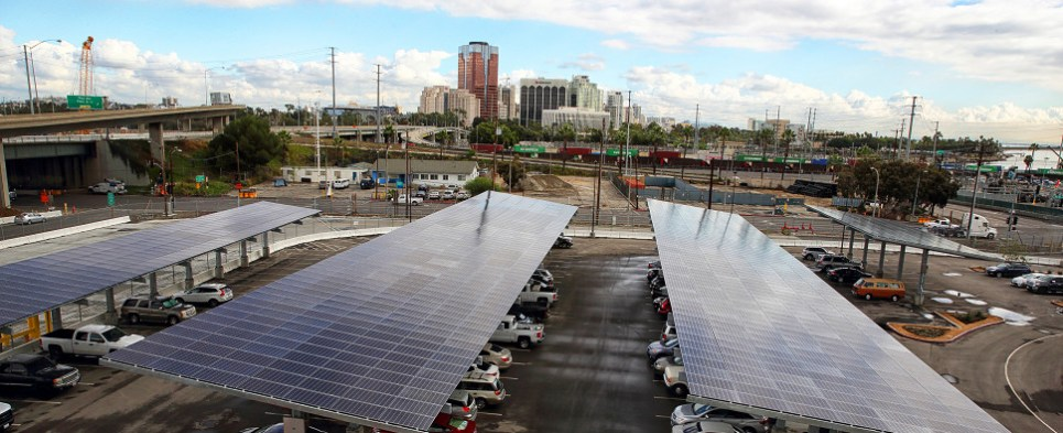 Solar panel powers container terminal at port of Long Beach that handles shipments of export cargo and import cargo in international trade.