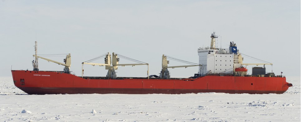 First shipments of export cargo and import cargo in international trade on northern Arctic route in winter.