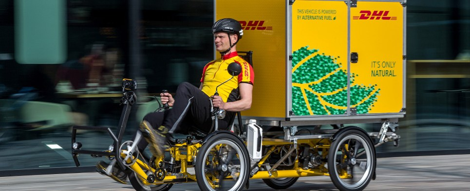 DHL using bicycles to deliver shipments of export cargo and import cargo in international trade.