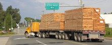 Flatbed trucks can carry shipments of export cargo and import cargo in international trade.
