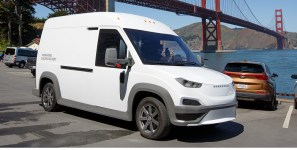 Electric vans to deliver shipments of export cargo and import cargo in international trade.