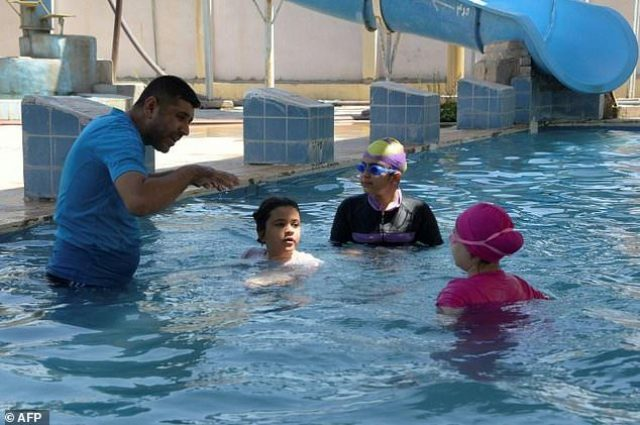 Iraqi girls take up swimming in IS-free Mosul