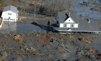 Coal sludge envelopes a house