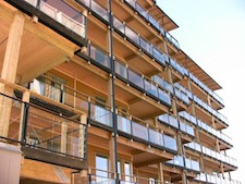What is the current trend in green building upgrades to multi-family buildings?