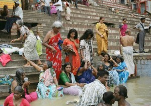 Families bathing in the Ganges, India