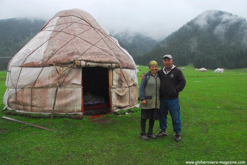 A yurt and its owners near Jeti-Oguz or Jeti-Ögüz, Kyrgyzstan. Rent the yurt for a few dollars per night. Three meals per day if you need it.