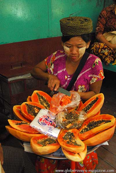 Lady selling papayas on the circular train around Yangon