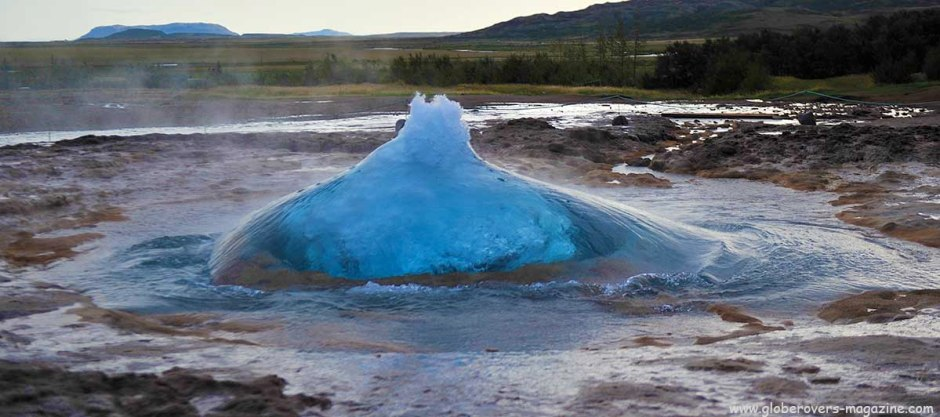Strokkur geysir a split second before eruption, Iceland